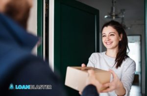 Woman Receiving Parcel from Delivery Man at the Door