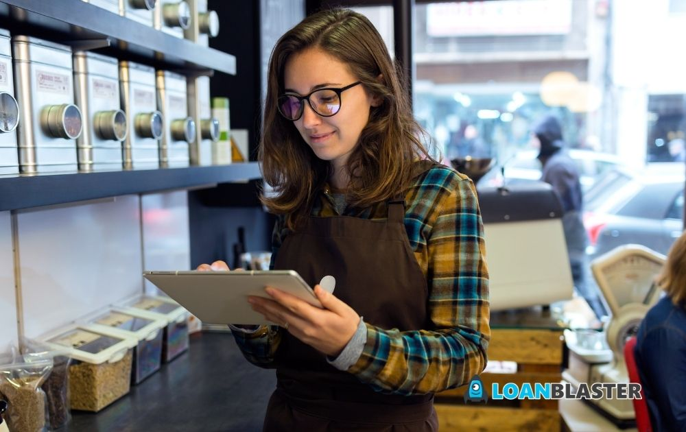 Beautiful Young business owner Doing Inventory in a Retail Store