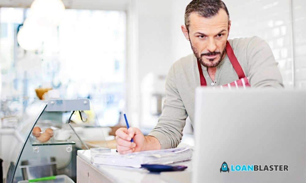 business owner calculating